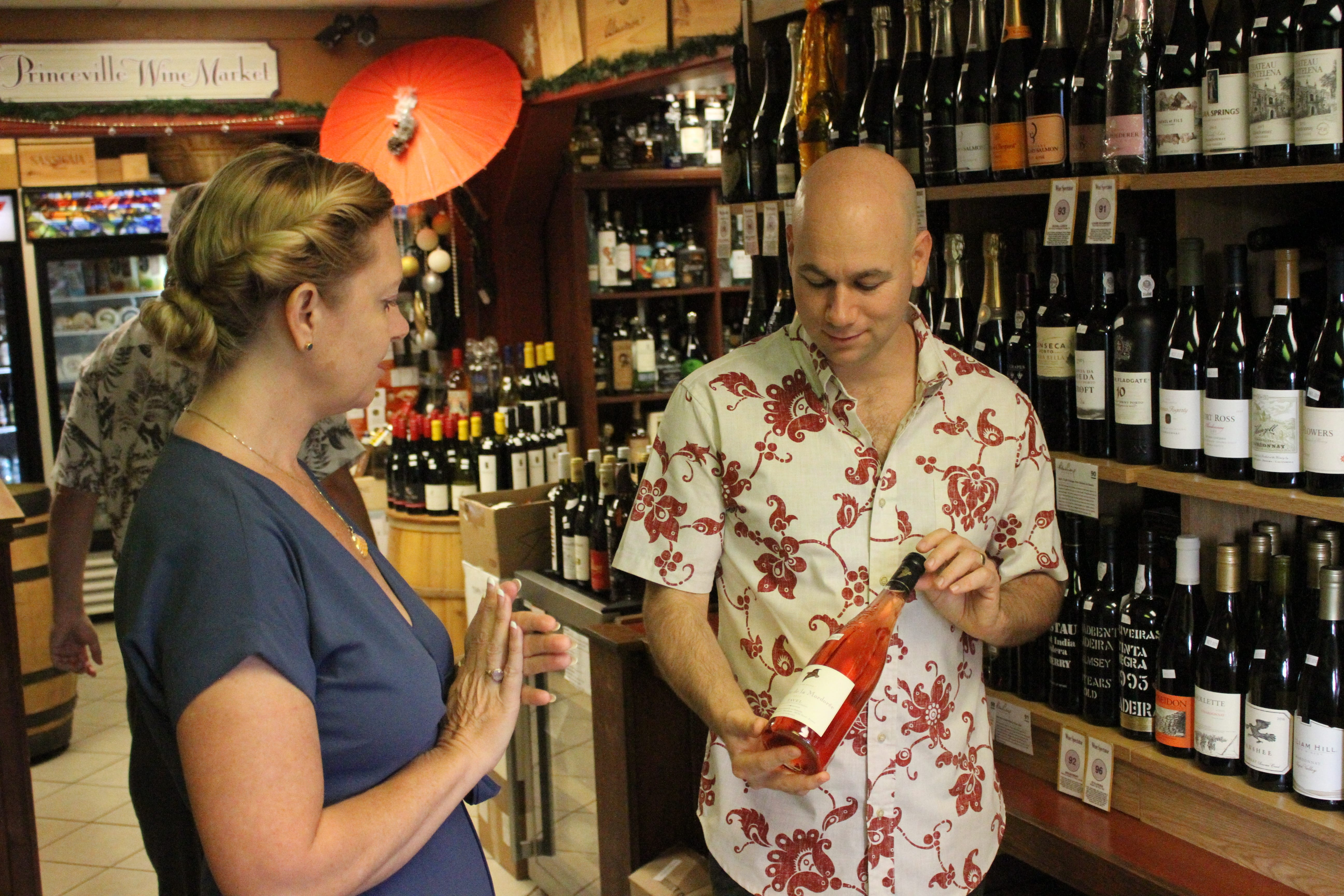 Daniel Braun discusses a wine at the Princeville Wine Market. We are all about matching the right person to the right wine.